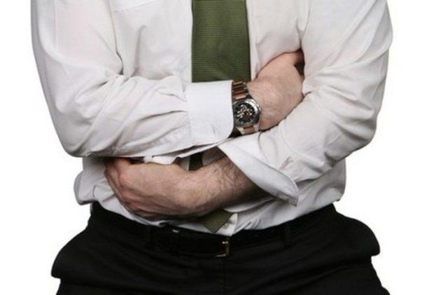 Болит живот в области и ниже пупка у мужчины